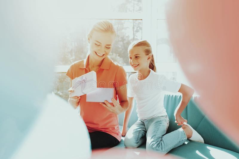 Little Daughter Is Giving A Present Box To Mum. Family Relationship Concept. Active Holiday. Beautiful Moment. Surprise To Parent. Happy Childhood. Celebrating royalty free stock photos