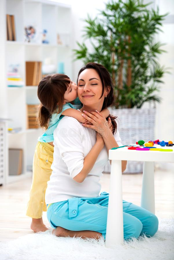 Little daughter hugs and kisses mom. Happy family and love. Mother`s day royalty free stock photography