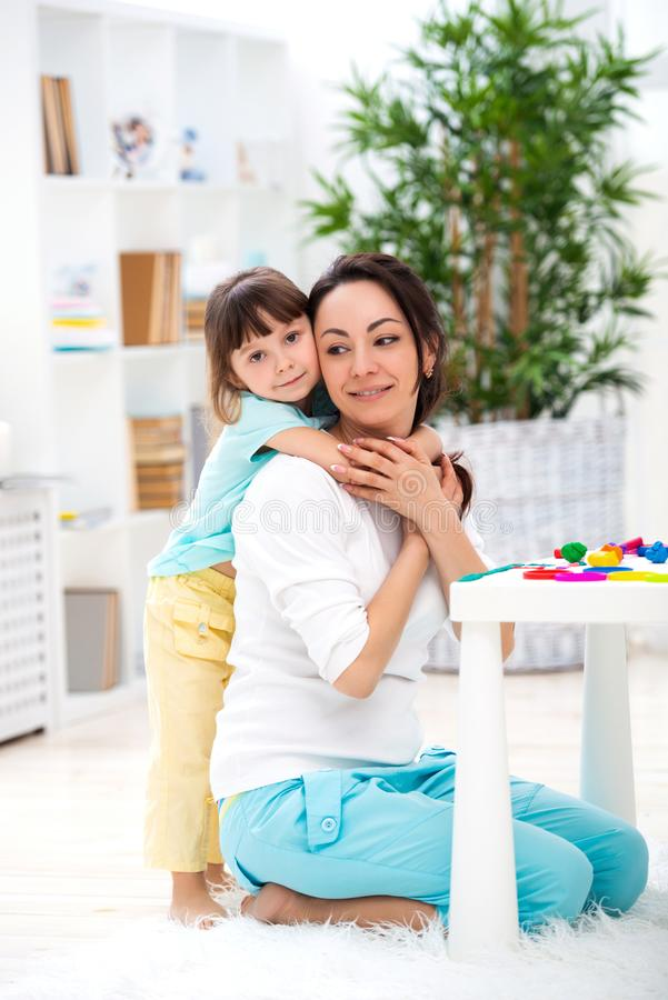 Little daughter hugs mom. Happy family and love. Mother`s day royalty free stock photo