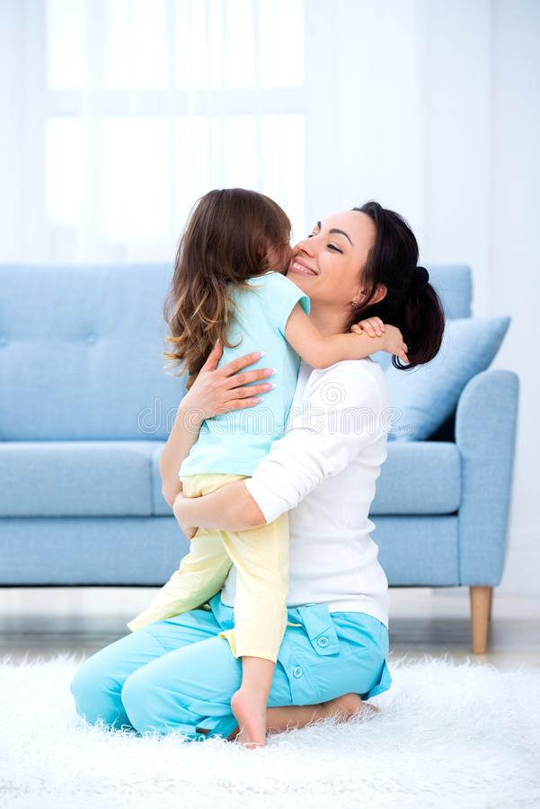 Little daughter hugs mom. Happy family and love. Mother`s day.  stock image