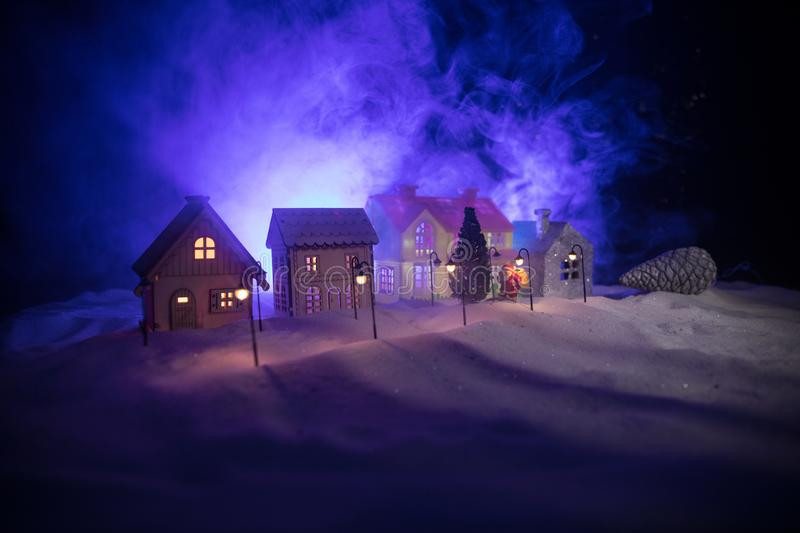 Little decorative houses, beautiful festive still life, cute small houses at night, Night city real bokeh background, happy winter stock photography