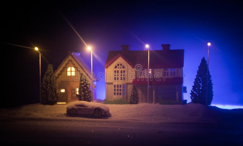 Little decorative houses, beautiful festive still life, cute small houses at night, Night city real bokeh background, happy winter royalty free stock photography