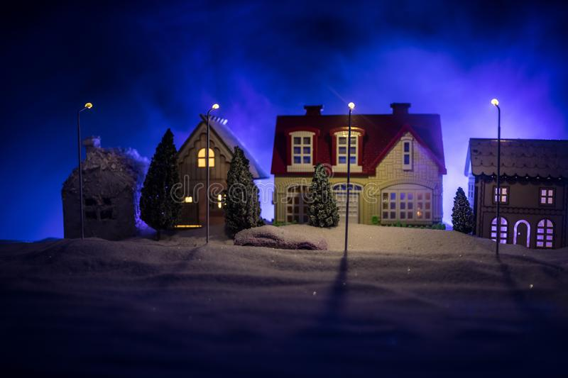 Little decorative houses, beautiful festive still life, cute small houses at night, Night city real bokeh background, happy winter royalty free stock photo