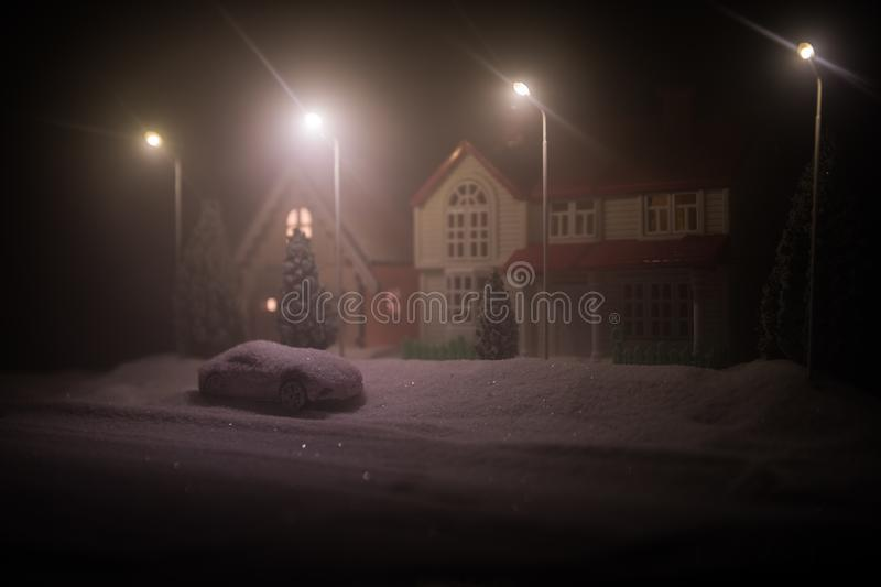 Little decorative houses, beautiful festive still life, cute small houses at night, Night city real bokeh background, happy winter royalty free stock images