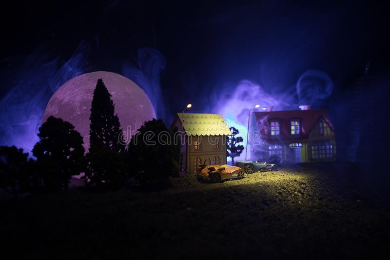 Little decorative houses, beautiful festive still life, cute small houses at night, pine trees glowing lights, happy winter holida stock image