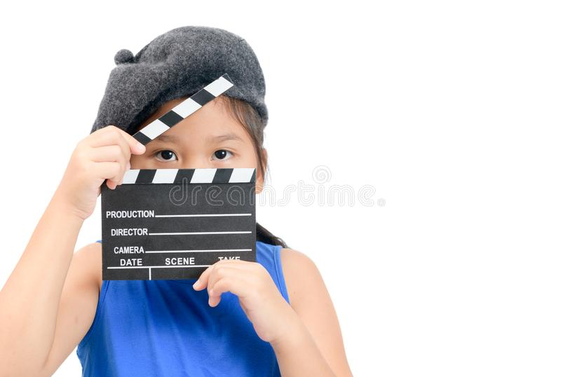 Little Director holding clapper board or slate film. For making video cinema isolated on white background and copy space. Movie and cinema concept royalty free stock photos