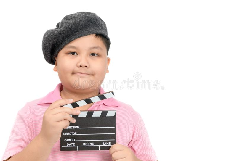 Little Director holding slate film for making video cinema. Little Director holding clapper board or slate film for making video cinema isolated on white royalty free stock images