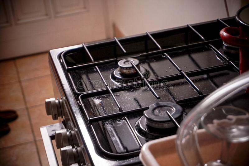A little dirty Gas stove in the kitchen stock photos