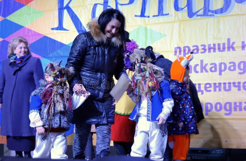 Little disguised children festive Carnival scene stock images