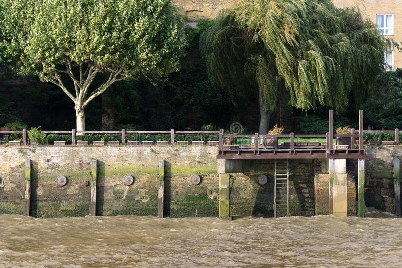 Little dock in the river Thames stock image