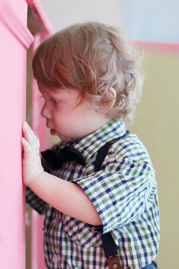 Free Little Dreaming Boy Looks Into Cabinet Stock Images - 56418904