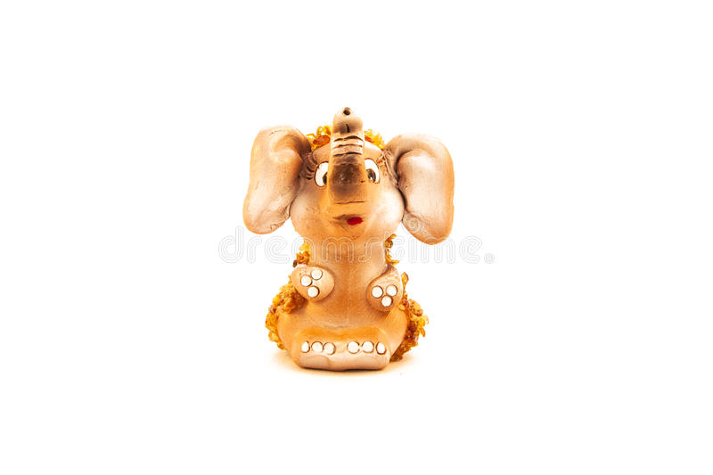 Little elephant with amber pieces stock photo