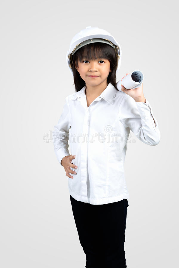 Little Engineer. Little girl in the construction helmet with a poster, Isolated over white royalty free stock photos