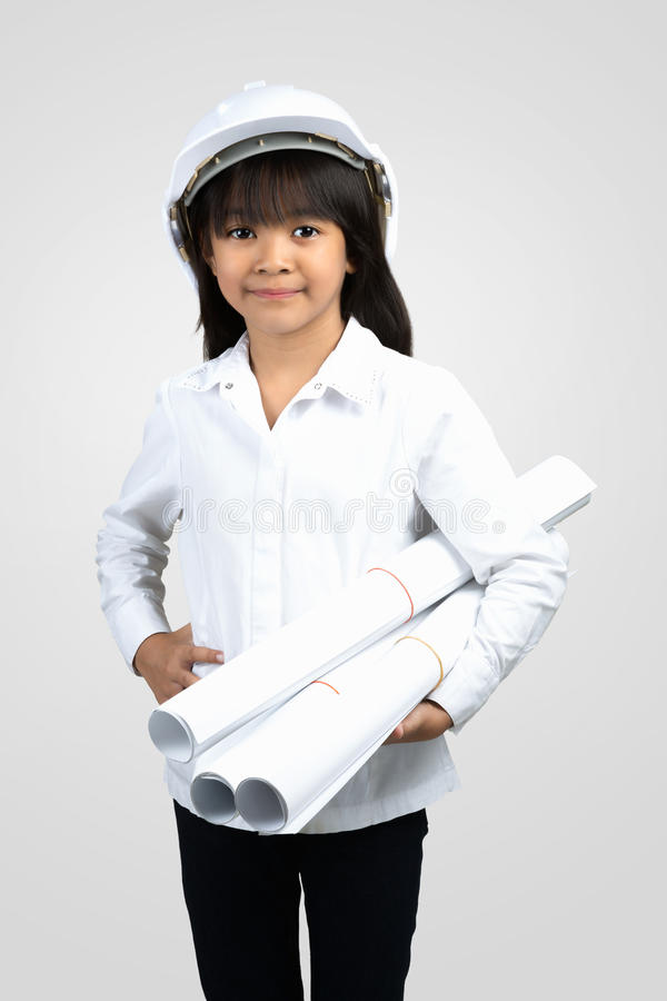 Little Engineer. Little girl in the construction helmet with a poster, over white royalty free stock image