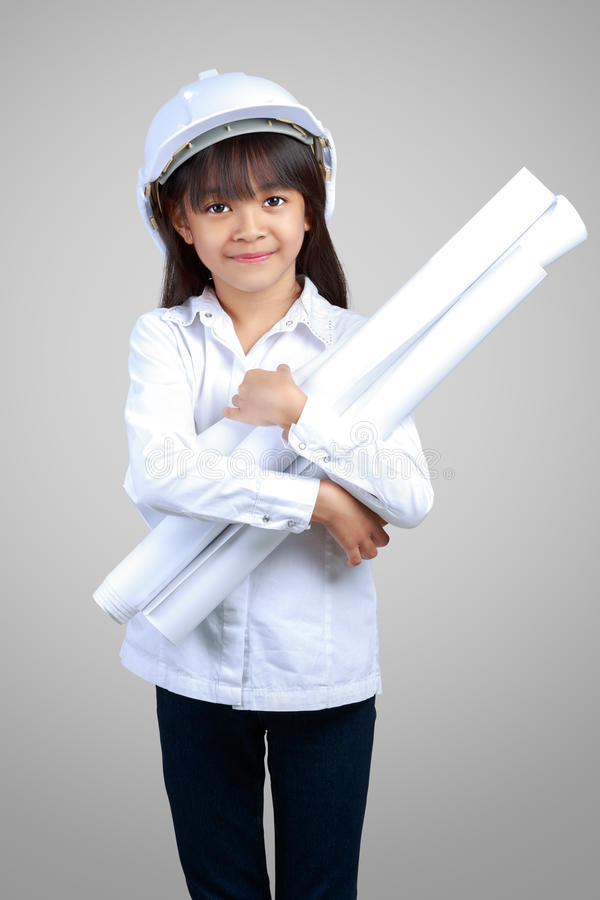 Little Engineer, Little girl in the construction helmet with a p stock photos