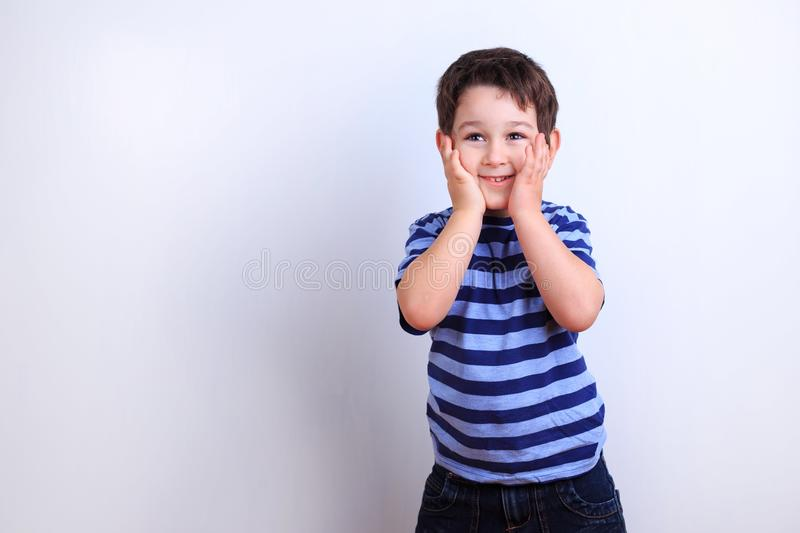 Little excited boy, studio shoot on white. Emotions, feelings, s stock image