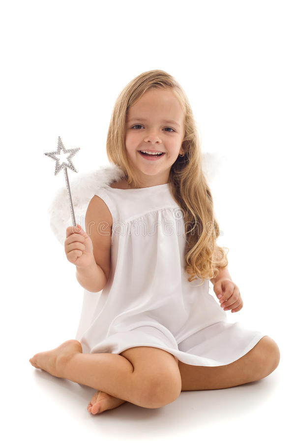 Little fairy angel with magic wand royalty free stock photos