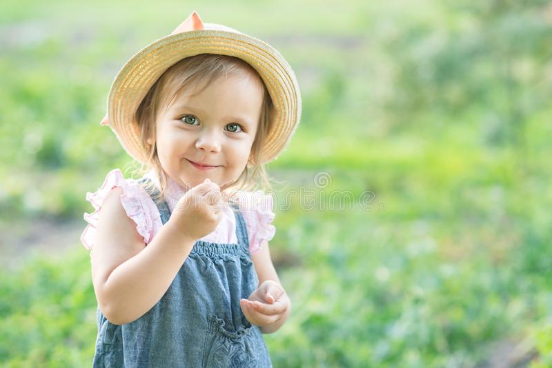 Little farmer child - lovely girl with picked vegetables royalty free stock images