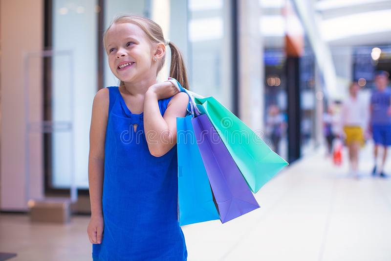 Download Little Fashion Girl With Packages In A Large Stock Photo - Image: 32915018