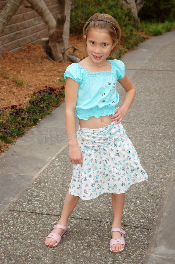 Little Fashion Model. Little girl does her fashion model pose in the latest of spring and summer fashion stock photo