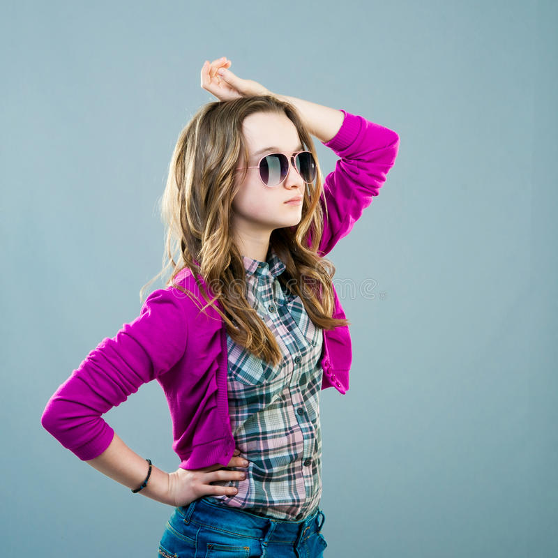 Little fashion model in sunglasses. Portrait of a beautiful little fashion model in sunglasses stock photography