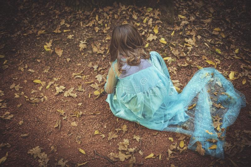 Little fashionable girl. Lonely little girl playing in the wood stock photos