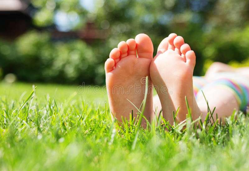 Little feet on the grass. Close up photo royalty free stock photography