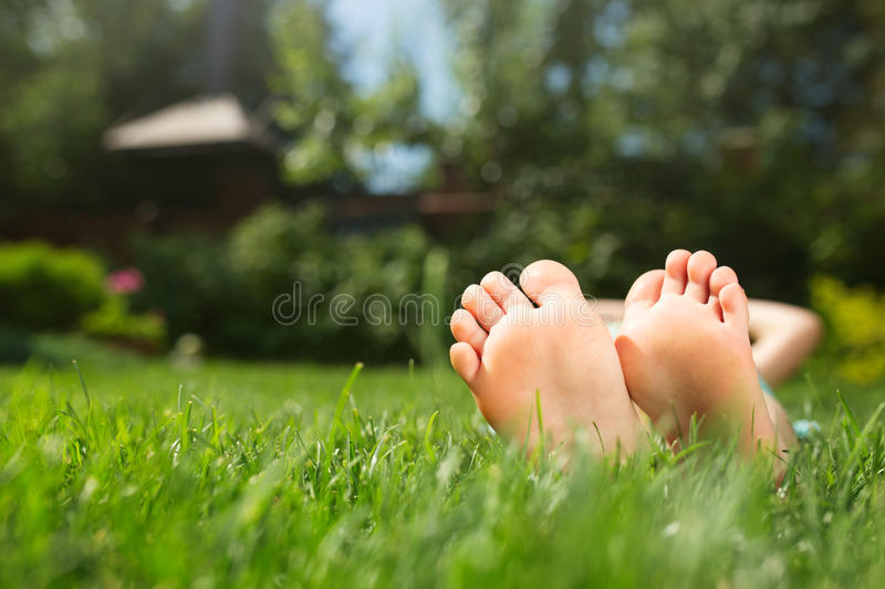 Little feet on the grass. Close up photo royalty free stock photo
