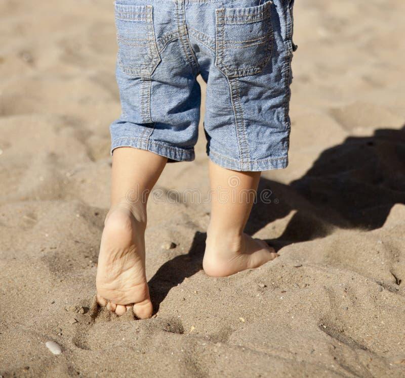 Little feet. Walking on sand royalty free stock image