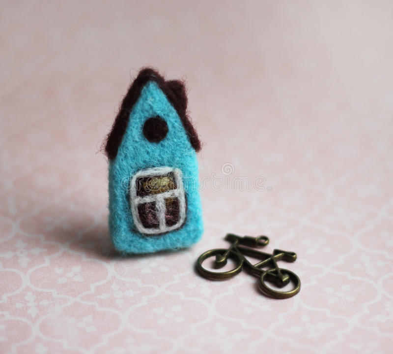 Little felted house, bicycle royalty free stock images