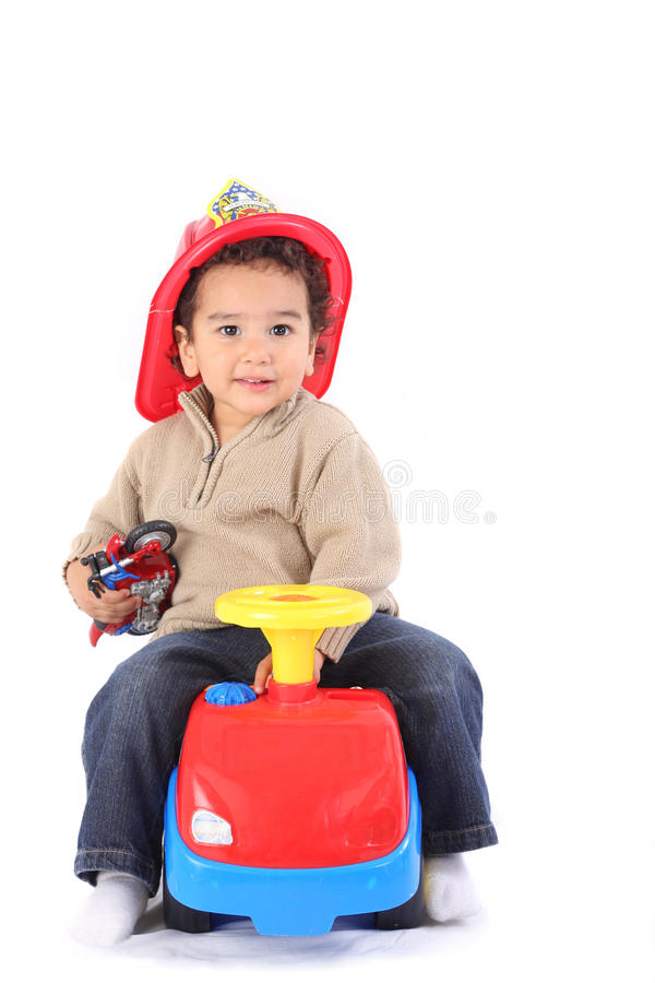 Download Little fireman stock image. Image of fireman, playing - 18567987