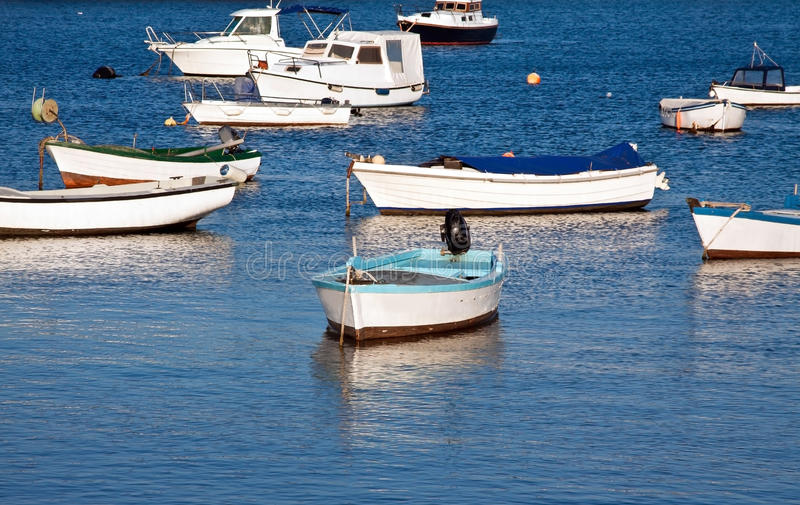 Little fishing boats. Several fishing boats relax on spring sun royalty free stock photo
