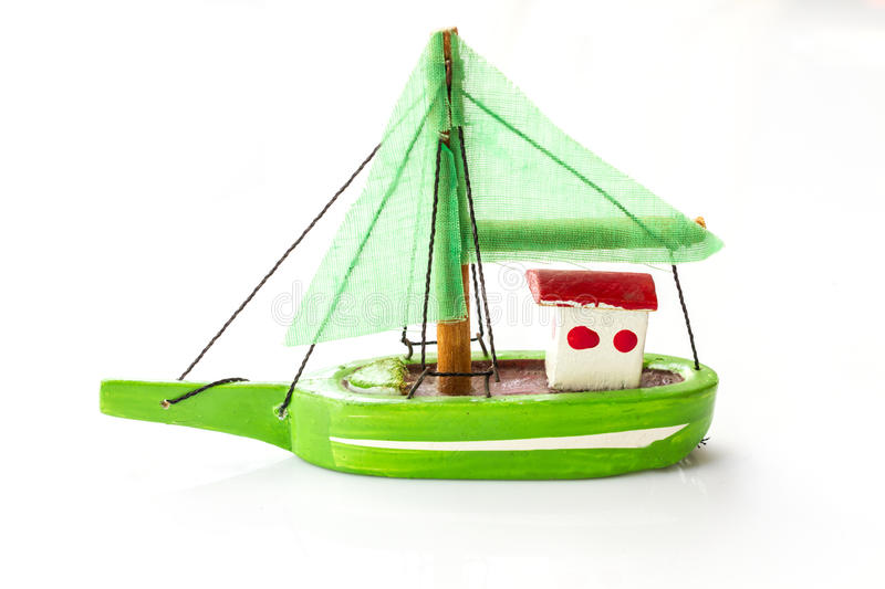 Little fishing ship model. Isolated on a white background stock image