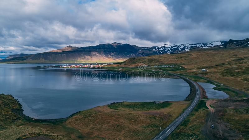 Little fishing village in iceland aerial view with sun. Drone royalty free stock image