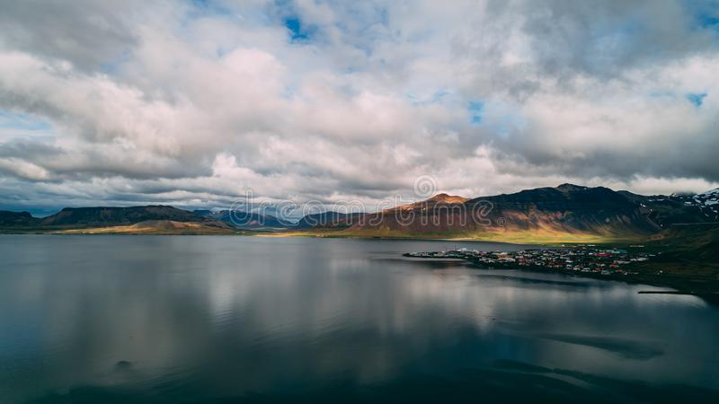 Little fishing village in iceland aerial view with sun. Drone royalty free stock photo
