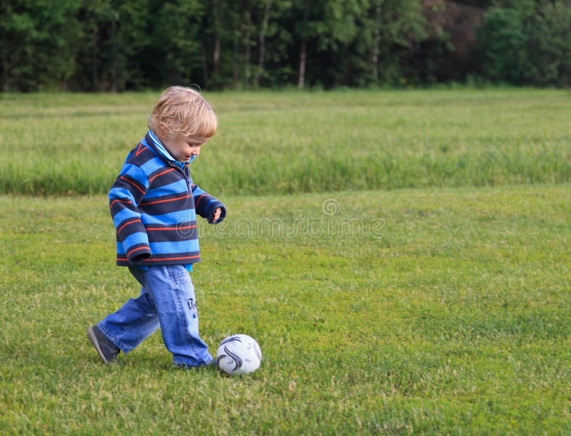 Little football player royalty free stock image