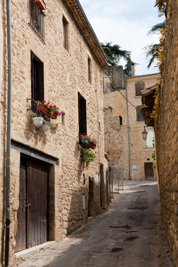 Little French lane. With generic houses ans flowers royalty free stock image