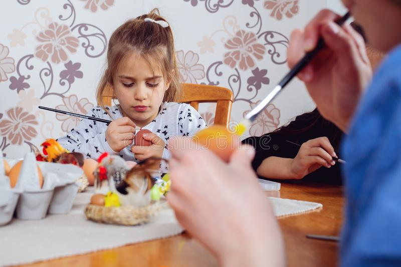 Little friends painting Easter eggs before holiday stock photo