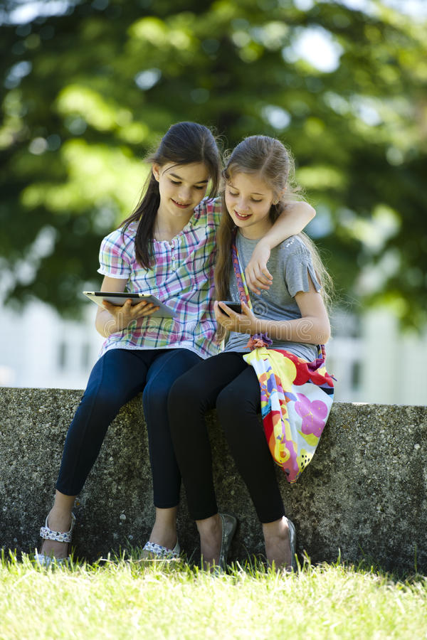 Little Friends With PC Tablet And Mobile Phone Royalty Free Stock Photo
