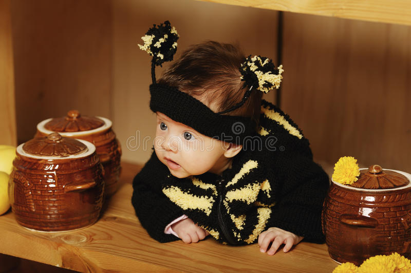 Little funny baby with bee costume royalty free stock photography