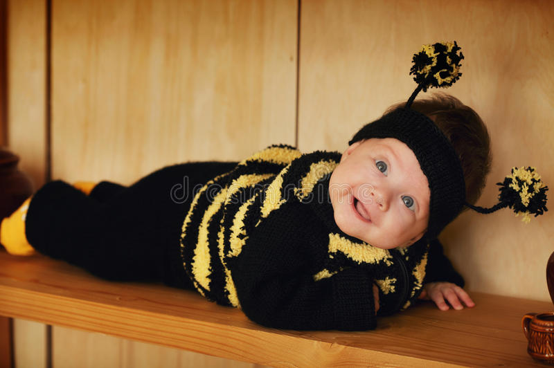 Little funny baby with bee costume stock photos