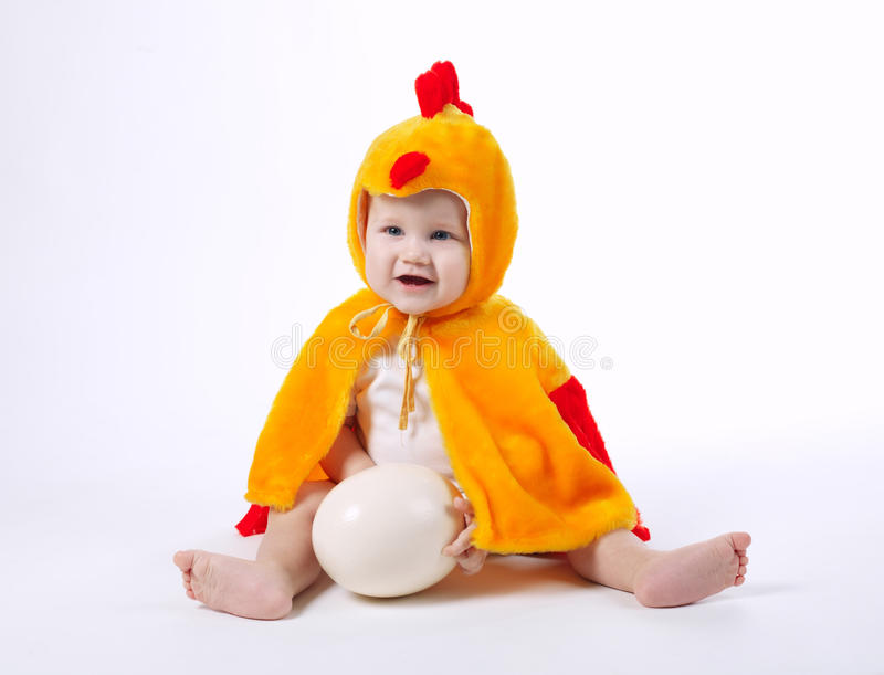 Little funny boy in chicken costume. On white royalty free stock photo