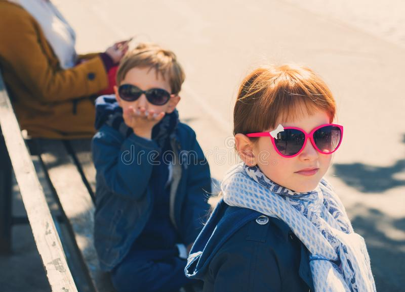 Little funny boy and girl outdoors royalty free stock photo