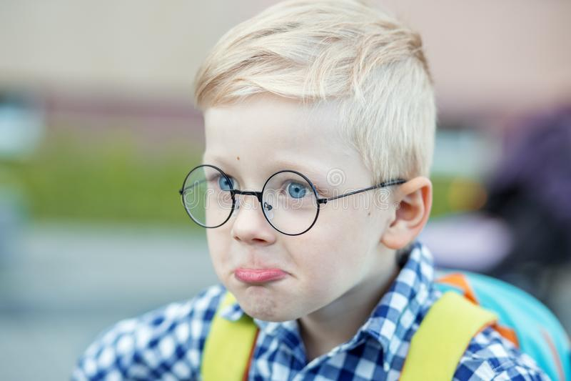 Little funny child thinks. This is an idea. The concept of learning, school, mind, lifestyle and success royalty free stock photos