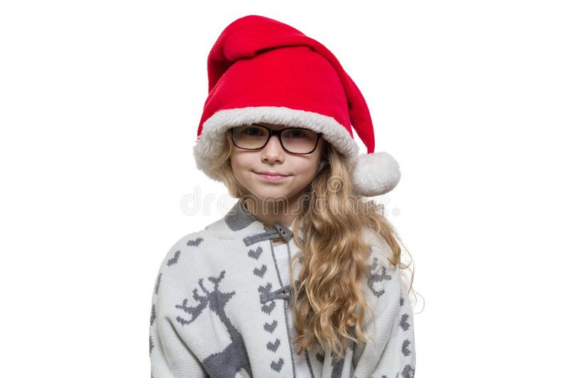 Little funny girl with glasses, Santa Claus hat, sweater with deer, isolated on white background stock images