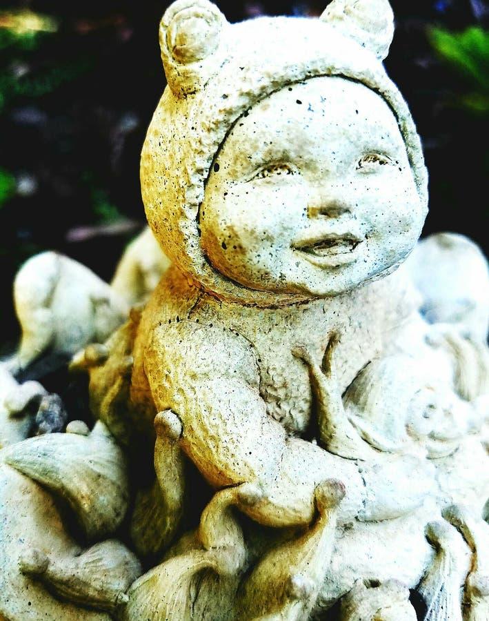 Little garden statue stock photo