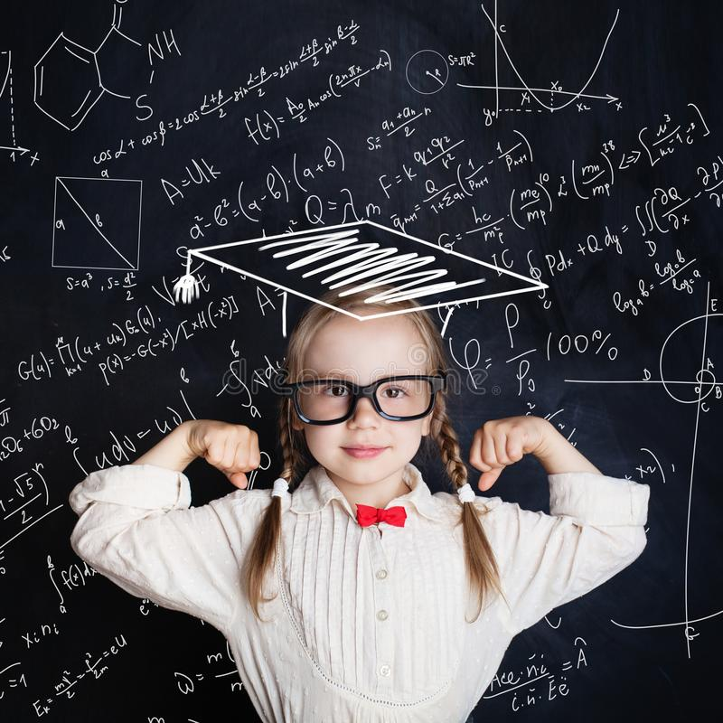 Little genius female child on hand drawings math science formula stock photos