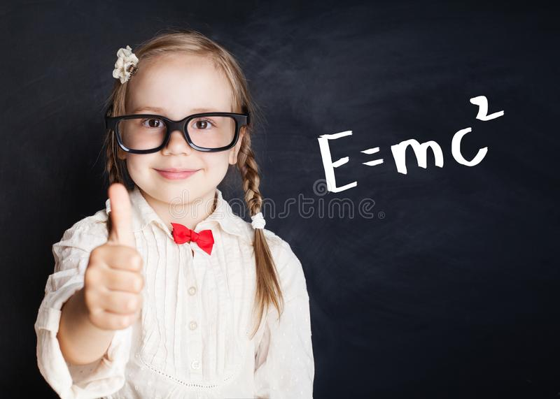 Little genius portrait. Kids mathematics education. Concept. Little girl with thumb up on hand drawings math science formula pattern stock image