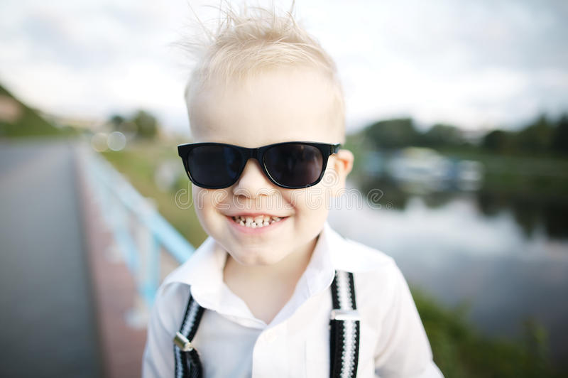 Little gentleman with sunglasses. Outdoors stock image