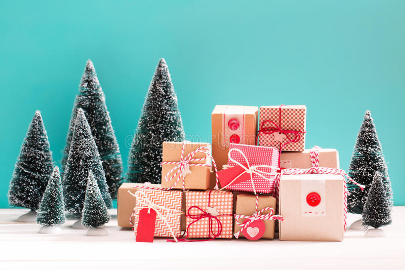 Little gift boxes in miniature evergreen forest royalty free stock image